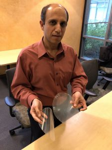 UC Davis food scientist Nitin Nitin with samples of antifouling, antibacterial plastic. The material could be used for packaging and for lining produce bins.